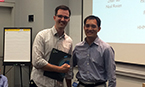Poster prize winner Rudolf Pisa with TPCB Director Derek Tan
