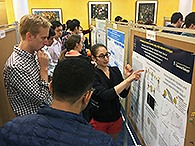 TPCB faculty member Dan Bachovchin judges a poster by TPCB student Rachel Leicher