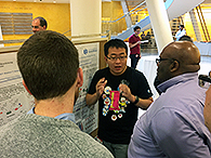 TPCB student Shi Chen presents his poster to Prof. Squire Booker