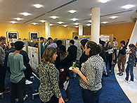 Attendees participate in the symposium poster session