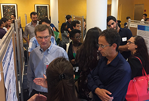 2019 Tri-I Chem Bio Symposium - poster session - Elizabeth Orth, Professor Craig Crews, Professor Ben Cravatt