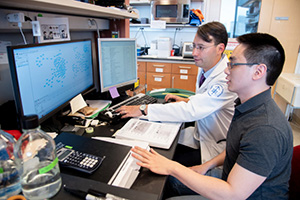 TPCB faculty member Prof. Alex Kentsis, working with TPCB student Zheng Ser